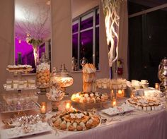 An impressive array of desserts, from cream puffs to chocolate dipped berries, is displayed for guests in addition to the cake.