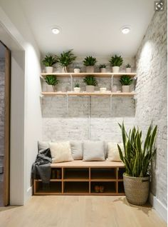 Storage bench with shoe storage, seating, and shelves above