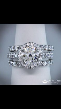 Amazing diamond ring...like the halo and the three bands.