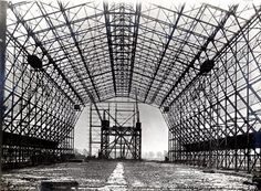 Cardington airship shed under construction 16 January 1916. Internal view of steelwork. One of a set of photographs to accompany a paper by T. M. Rounthwaite; 'The Royal Naval Air Works, Cardington, Bedford, with some notes on their construction'  which was read before the ICE Newcastle-upon-Tyne local association 27 February 1922 (ref 0C4453)