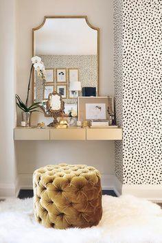 gold floating makeup vanity nook gold velvet tufted pouf gold leaf mirror,  dalmation dot wallpaper, and faux fur rug