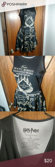 Harry Potter Marauder's Map Sleeveless Dress Super cute fit and flare sleeveless dress for everyday wear or conventions. It's an official Harry Potter product featuring images from the Marauder's Map. Black and parchment color. Made of polyester and spandex. It's a size extra small. In nice preowned condition, no stains, tears, or other visible flaws. Dresses