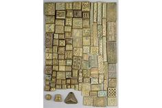 A collection of Ashanti gold weights Ghana brass with cast geometric designs, the longest 6cm. (1
