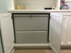 Until the doors are opened, the file cabinet is hidden. With the pull out shelf on the side, it is easy to add and remove files without having to move things on the credenza.
