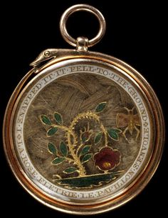 An English mourning locket, enamelled gold set with plaited hair, c.1810; a serpent, symbol of eternity, encloses the locket, on which is depicted a drooping rose bush and butterfly; the inscription is translated as 'The rose withers, the butterfly flies away and Napped it fell to the ground'; on the back, 'And such I exclaim'd is the pitiless part, some art by the delicate Mind, Regardless of Wringing and Breaking a Heart, already to sorrow resigned'. (Victoria & Albert Museum)