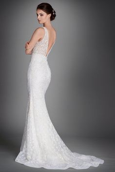 Lazaro - Alexis  Mermaid wedding dress in ivory crystal embroidered lace with plunging 'V' neckline and embellished straps. Features low back to waist, sheer beaded bodice, and intricately beaded skirt with horsehair hem and chapel train.  Category: Lazaro, wedding dress Silhouette: Mermaid Neckline: V-neck Colour: As shown