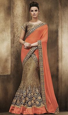 Drive away the gloom dressed in this beige and peach color embroidered lehenga sari. You'll see some intriguing patterns performed with lace, resham and patch work. Upon request we can make round front/back neck and short 6 inches sleeves regular sari blouse also. #lehengasareesonline #embroideredlehangasari #traditionallehengasaris