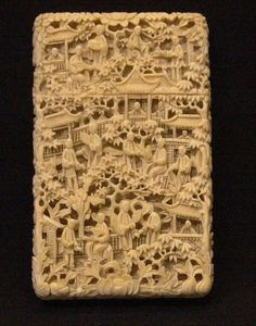 A 19th century Chinese ivory card case Profusely carved with figures within a continuous landscape. 10.5 cms high.