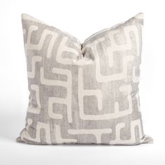 This light gray and sandy beige pillow will add the subtle graphic impact your space is craving. The abstract and dynamic pattern has a hand-blocked look, and delivers artisanal flair with a modern edge. Beige Pillows, Silver Pillows, Modern Throw Pillows, Round Stool, Large Sofa, Handmade Pillows, Decorative Accessories, Fabric Design