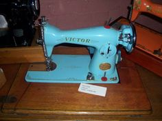 Tensioner on the end and looking very much like a singer 15 class design.. Yep a CLONE... Badged for Victor  which became Myer Victor for the department store Myers in Oz.