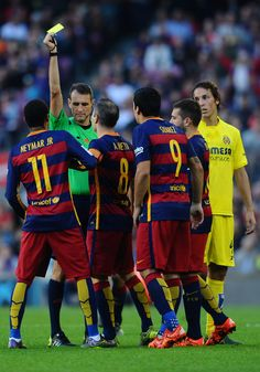Neymar of FC Barcelona is shown a yellow card by the referee Clos Gomez during the La Liga match between FC Barcelona and Villarreal CF at Camp Nou on November 8, 2015 in Barcelona, Catalonia.