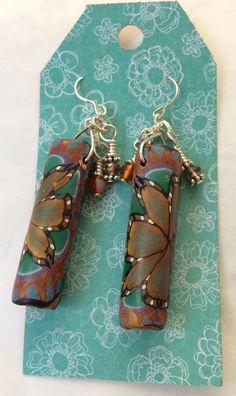 Copper green earrings.