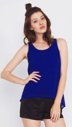 Major Laser Top*This is a royal blue tank top with laser cutout detail. If you want to pull this into a great going out look, pair it up with some fun pattern shorts and chunky jewelry. #blue #top