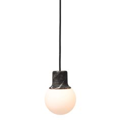 The design ofbrown marble Mass Light NA5 is based on thestreet lamps from Paris, Barcelona and New York. NORM architects Kasper Rønn and Jonas Bjerre-Poulsen were fascinated by the characteristic cast iron top - looking a bit like a hat - with a semi transparent glass sphere at the base.