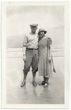 couple at the beach, woman wearing dress and hat, man wearing knickers, bow tie, hat, 1920s.