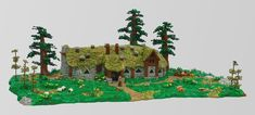 Take a trip to a corner of Middle Earth in Mountain Hobbit and Cole Blood's LEGO version of Beorn's cottage Lego Castle, Thatched Roof, Lego Architecture, Lego Models, The Brethren, Big Tree, Cool Lego, Lego Creations, Lodges