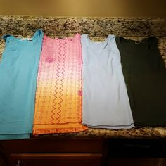 T-shirt Bundle! This is a great little bundle made up of 4 cute and comfortable cotton t-shirts! These short sleeve tops are perfect with jeans or working out! The deeper blue is XL Cherokee, the pink/orange is 1X Havana Jacks, the sky blue is XL Russell Athletics and the forest green fits an XL.  With the exception of one tag that has been removed (green), these tops are in great condition! Cherokee, Russell + others Tops Tees - Short Sleeve