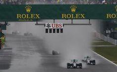 Mercedes driver Nico Rosberg of Germany, left, leads Mercedes driver Lewis Hamilton of Britain at Japanese Formula One Grand Prix at the Suzuka Circuit in Suzuka, central Japan, Sunday, Oct. 5, 2014.(AP Photo/Shuji Kajiyama) ▼5Oct2014AP|Hamilton wins Japanese GP marred by Bianchi crash http://bigstory.ap.org/article/6ab2db9571da4d238e52283c67f99c2a/hamilton-beats-rosberg-win-japanese-gp