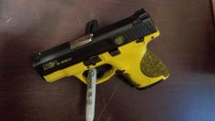 My custom smith and wesson shield 40 Love this in yellow. I wonder. Smith And Wesson Shield, Smith N Wesson, Zombie Guns, S&w Shield, Battle Rifle, Concealed Carry, Shotgun, Firearms, Knives