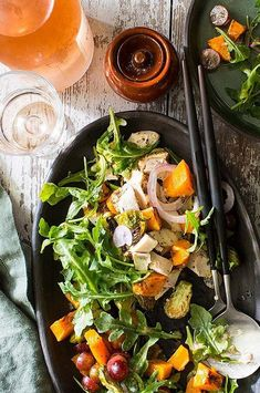 Hot roasted vegetables lightly wilt the arugula in this healthy dinner salad recipe. Keep prep time minimal with leftover chicken, precut butternut squash and trimmed Brussels sprouts. #salads #saladrecipes #healthysalads #saladideas #healthyrecipes