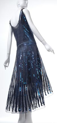 """Gabrielle """"Coco"""" Chanel (French, 1883-1971). Evening Dress and Slip, 1928, metal sequins on silk tulle. Collection of Phoenix Art Museum, gifts of Mrs. Wesson Seyburn. Photographs by Ken Howie."""