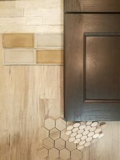 Love these natural earth tones! Nothing beats designing beautiful spaces on a rainy day! Featuring a super durable vinyl plank flooring, marble hexagons and ovals, crackle glazed subways, white oak splitface stone, and a beautiful dark stained cabinet from @cabinetrybyksquared. Come into Palm Tile as your one stop shop for all remodeling needs!  #palmtile #remodel #remodeling #design #interiordesign #tile #tiledesign #cabinets #kitchen #kitchendesign #bathroom #bathroomdesign #stone
