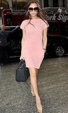 Making the most of being in New York after her Fashion Week success, Victoria Beckham took baby Harper on yet another shopping trip in the Big Apple, worrking a stunning peach shift dress with a black handbag - both from her own collection, along with nude platform Christian Louboutin heels. W