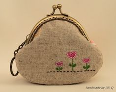 coin purse------ clutch purse with hand embroidery love hearts. $22.00, via Etsy.