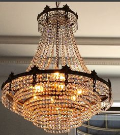 This glittering vintage crystal chandelier sets the mood in our #EstateJewelry…