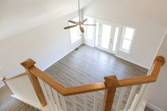 Oak handrail with white balusters, overlooking Great Room. Oak Handrail, Beach Homes, Great Rooms, Coastal, Beach Houses, Beach Apartments