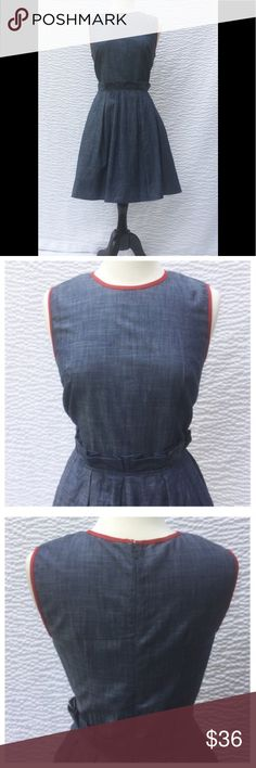 "New Eshakti Chambray Fit & Flare Dress L 12 New Eshakti chambray fit & flare dress L 12 Measured flat: underarm to underarm: 37""  Waist: 31"" Length: 38 1/2""  Eshakti size guide for 12 bust: 38 1/2""  Bodice darts to shape, back hidden zipper, red contrast piped trim. Seamed wiast w/ box pleats, flared skirt w/ side seam pockets. Cotton, woven chambray, cross dyed, no stretch, machine wash. New w/cut out Eshakti tag to prevent returning to Eshakti. eshakti Dresses"