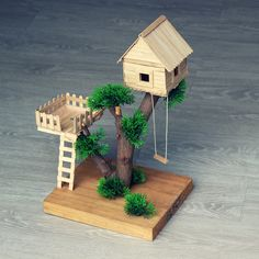 See the video on how to build this popsicle stick house, t… KANIA KANIA Popsicle stick house. See the video on how to build this popsicle stick house, tree house or fairy house on the Curious Crafter… Continue Reading → Popsicle Stick Crafts House, Craft Stick Crafts, Diy With Popsicle Sticks, Popsicle Stick Birdhouse, Resin Crafts, House Tree Plants, Fairy Tree Houses, Diy Home Crafts, Tree Crafts