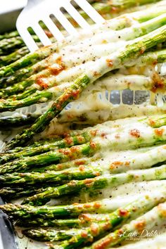 Cheesy Garlic Roasted Asparagus with mozzarella cheese is the best side dish to any meal! Low Carb, Keto AND the perfect way to get your veggies in! Even non-asparagus fans LOVE this recipe! Tastes so amazing that the whole family gets behind this one.