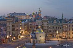 Main Market Square. Saint Adalbert church (Swietego Wojciecha) and Wawel castle in the distance - Cracow, Poland