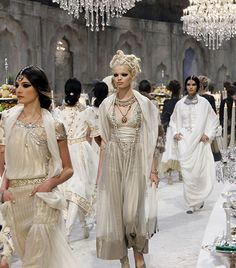 @Who What Wear - Chanel Pre-Fall 2012                 Location: The Grand Palais in Paris, France  Only Lagerfeld could conjure such extravagance for a pre-collection presentation. Drawing inspiration from Indian palatial excess, he transformed the Grand Palais in Paris into a luxurious maharajan dining room, complete with crystal candelabras, tiers of sweets and fruits, and even a toy train carrying scotch. In keeping with the décor, the models paraded in silk harem pants, saris draped…