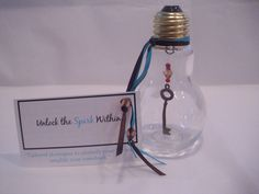 THIS IS A SAMPLE OF WHAT I CREATE! This kit contains a light bulb with an antique key and beads inside, additional beads, ribbon, and business card with catch phrase. Light Bulb Art, Cold Calling, Antique Keys, Attraction, Stuff To Do, Perfume Bottles, Ribbon, Bright, Kit