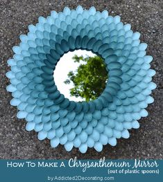 chrysanthemum mirror made out of plastic spoons.  Way cute.