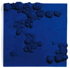 Yves Klein (1928-1962), Rélief éponge bleu (RE 51). Photo: Christie's Images Ltd 2012  signed and dated 'Yves Klein 59' (on the reverse); dry pigment in synthetic resin, natural sponges and pebbles on board, 40 3/8 x 41 3/8in. (102.5 x 105 x 10cm.). Executed in 1959