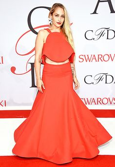 Jemima Kirke chose a blood-orange ball gown with a ruffled bodice and a cutout at the waistline, which she accessorized with giant, daisy-shaped earrings.
