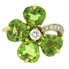 View this item and discover similar for sale at - Adorable yellow gold ring, set with peridot flower petals, adorned with approx. Ring is a size 6 ring top is x Peridot Jewelry, Birthstone Jewelry, Gemstone Jewelry, Peridot Rings, Diamond Flower, Gold Diamond Rings, Yellow Gold Rings, Gold Flowers, Flower Petals