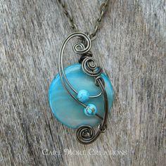 Cyan Mop Shell Wire Wrapped Pendant Necklace in Gunmetal Wire.  Trinkette. $25.00, via Etsy.