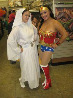 Princess Leia and Wonder Woman cosplay.  Coliseum of Comics Re-Opening, Orlando, FL.  Leia costuming by Rebel Princess Cosplay & Costuming. 2013