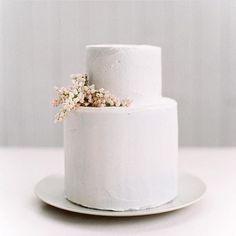 simple florals on an all white wedding cake. #Regram via @honeybpaperco