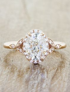 Rose - what a precious color. Our Rachael is 14k rose gold elegance and mystic wrapped into one. She has a GIA certified brilliant, conflict free oval cut diamond at her center that we know will make your partner's heart melt.