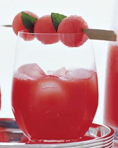 Watermelon sangria: In a blender, puree the watermelon cubes. Pour through a fine strainer into a pitcher. Add the white wine, vodka, Cointreau and Citrus Syrup. Stir and refrigerate for at least 2 hours. Stir again, then pour the sangria into ice-filled white wine glasses and garnish with the skewered watermelon balls.