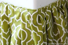 How to make a pleated table skirt that is attached with velcro.  Going to do for my craft room tables!