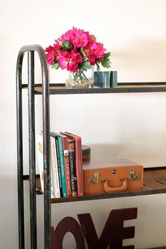 Add some antique industrial chic to your home decor!    Use as a bookcase, tv console, garden plant stand... anything you need to organize! Ample room for most any household items.     Be sure to see our bright and festive home decor items at www.CreativeHomeDecorations.com