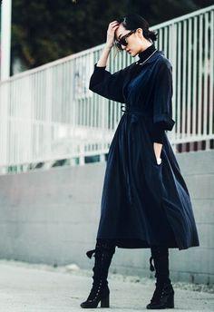 Chriselle Lim wears a turtleneck, wrap dress, and lace-up Chloé boots