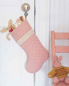 While kids are tucked tightly into their beds, their littlest gifts can be tucked inside a quilt stocking. Use a thick old quilt or plushy bedspread to make it. With a cutout stocking template, you can easily decide which part of the blanket will yield the best-looking stocking. Position the template so that the top of the stocking falls along a hemmed edge to make sewing a snap.