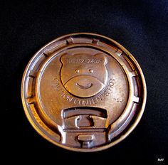 Plastic Bear Coffee Cup Cover cast in bronze, Modern Art Foundry/Spring Gallery.